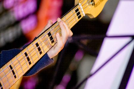 Musician playing a bass guitar Stock fotó