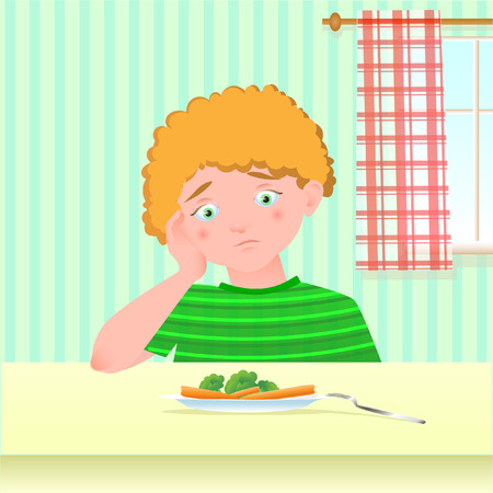 A boy who does not like to eat vegetables Standard-Bild - 100704730