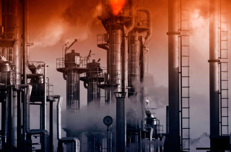 oil refinery with giant flames and fire, red sunset and smog