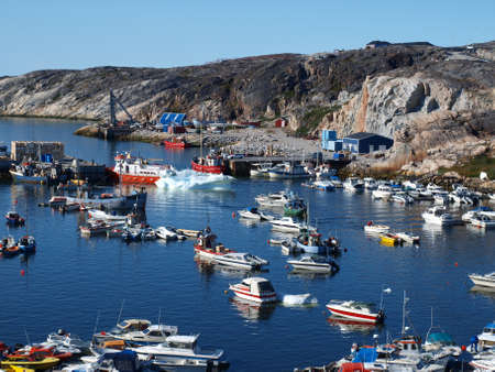 Ilulissat harbour blocked by floating ice brought by the tide.