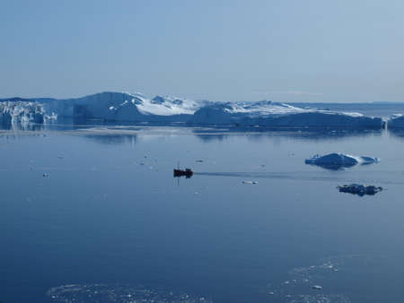 Fishing boat in Ilulissat Icefjord, Greenland. Stock Photo
