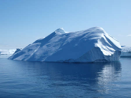 Iceberg south of Ilulissat, from the boat doing Greenland west coast ferry Stock Photo