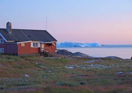icefjord: Icebergs , Ilulissat shore at dusk, Greenland. Stock Photo