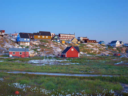 Ilulissat, west Greenland coast at dusk Stock Photo
