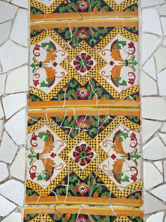Gaudi Mosaic Tiles with rain drops - Barcelona, Spain, park Guell Stock Photo