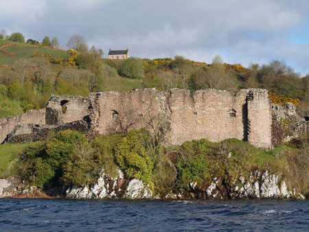 Urquhart Castle, Scotland, seen from the Loch Ness in may. photo