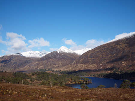 Snow covered Creag a Chaorainn and An Tudair Beag, seen from  Loch Affric, Scotland in may