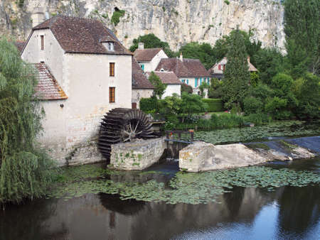 Watermill and paddle wheel  on Vienne river, Angles sur Anglin Stock Photo