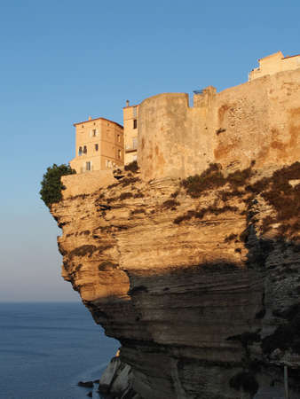 Bonifacio limestone cliff at sunrise, Corsica, France photo
