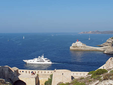 Yacht seen from the Genovese fortifications, leaving Bonifacio bay