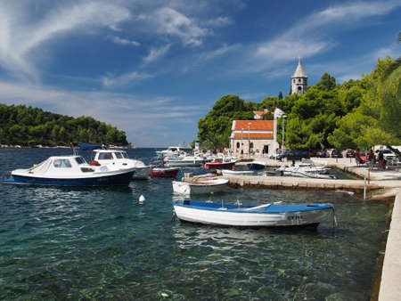 Cavtat, Croatia, august 2013, harbor, with monastery of Our Lady of the snow in the background Editorial