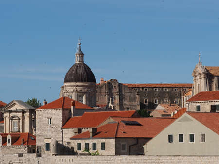 Cathedral in the historic town Dubrovnik amongst tiled roof, Croatia