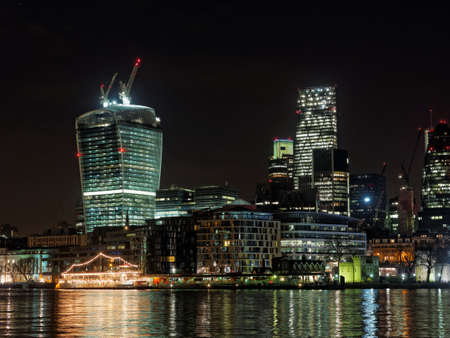 LONDON  DECEMBER 2013, Thames waterfront at night  with the famous Walkie-Talkie or The Pint commercial skyscraper under construction on december29, 2013