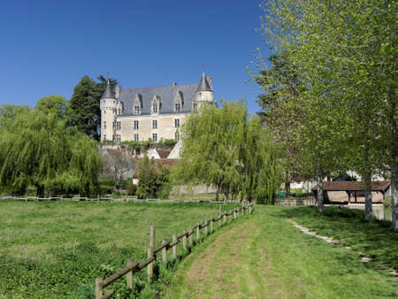 Montresor castle and village seen from a grass path, Indrois valley, France