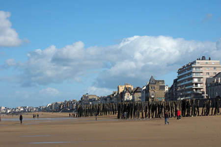 Saint Malo seafront at low tide, with wood breakwaters, april 2014