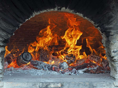 wood burning in a brick domed ceiling bread oven