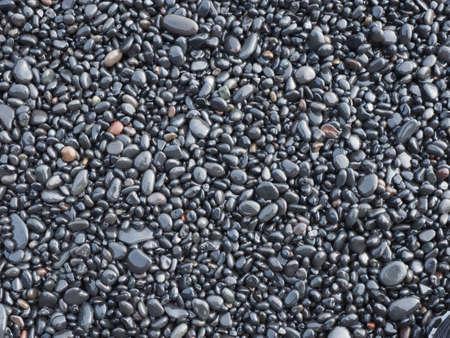 fundo de pedras de basalto molhados de Vik costa, Isl�ndia