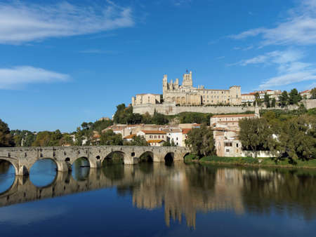 Beziers old city and pont vieux (old bridge) on the river orb in autumn Stock Photo