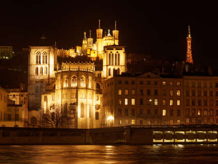 The Notre Dame de Fourviere basilica and the St. Jean cathedral illuminated Both, in Lyon, France.