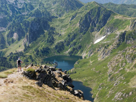 french pyrenees, hiker overlooking a lake