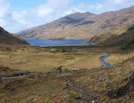 Finiskaig river flowing into Loch Nevis, seen from the Cape Wrath trail, Scotland Higlands, west coast Reklamní fotografie