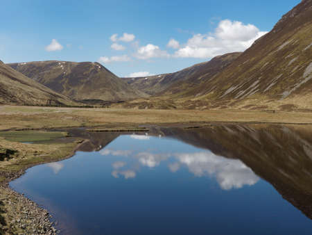 Gaick pass with Loch Bhrodainn and A Chaoirnich corbett in the background, Scotland in may Reklamní fotografie