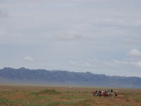 Camel riding is a popular tourist activity in the Gobi Desert,Mongolia.