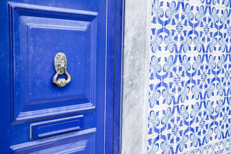 Lisbon, Portugal: blue door and azulejo