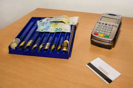 money Euro, payment terminal and credit card on the desk Imagens