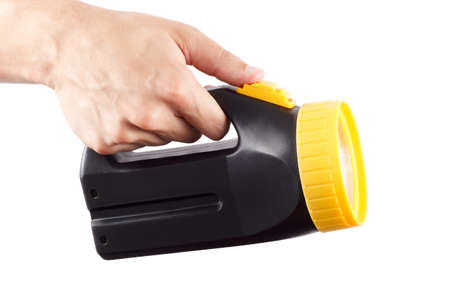 Hand holds black and yellow flashlight photo