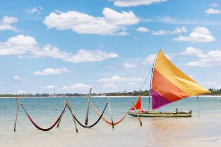 beautiful sail boat and hammocks at the Paradise Lake  Jericoacoara, Brazil  photo
