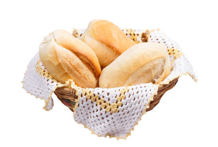 three breads in wicker basket isolated on white background photo