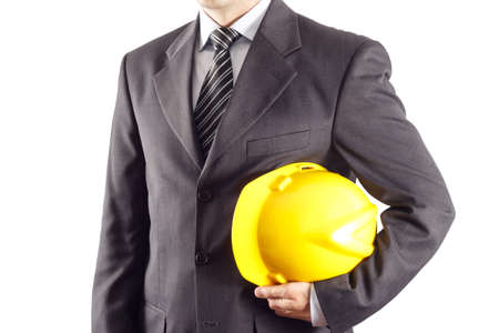 constructors: businessman or engineer holding a helmet under his arm against white background