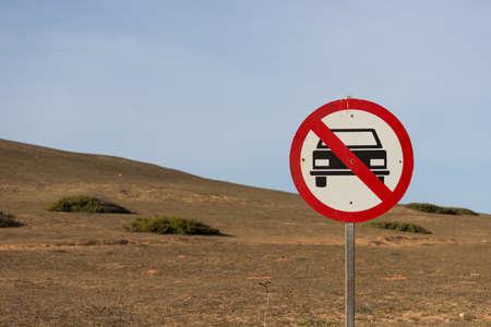 abstain: forbidden car sign near to a mountain