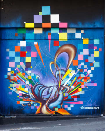 BELO HORIZONTE, BRAZIL - JUNE 8, 2014: Street art by SeresGraff. Even with the lack of support, artists exhibit their graffiti work as a vibrant urban culture in streets of Belo Horizonte.