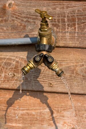 Faulty outside water tap causing water waste photo