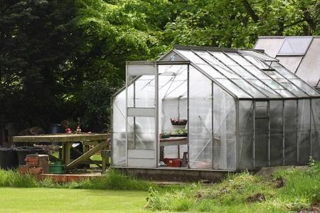 A garden greenhouse in an English country garden