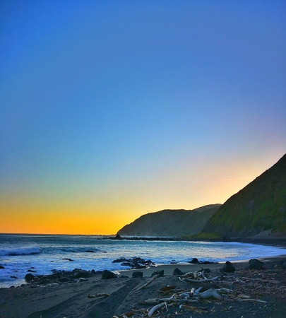 The sunset in Owhiro Bay New Zealand