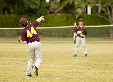 outfield: Kids playing Baseball in youth league