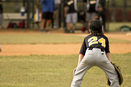 Kids playing Baseball in youth league photo