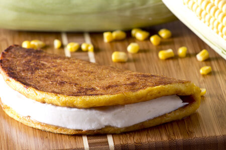 close up food: Corn tortilla with white cheese typical venezuelan food.