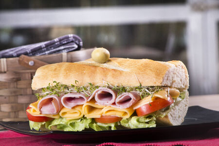 hero sandwich: Submarine Sandwich with ham and cheese for food uses