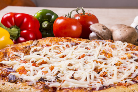 parmezan: Sliced pizza with melted mozzarella and parmezan cheese