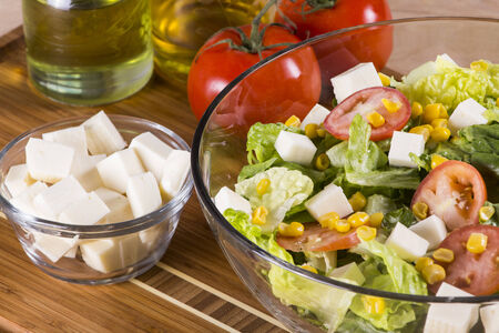 greek currency: Traditional greek salad with corn, feta cheese, tomatoes and lettuce. Stock Photo