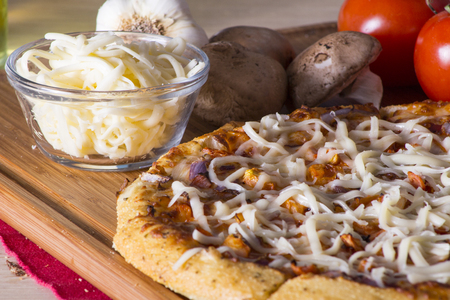 parmezan: Sliced pizza with melted mozzarella and parmezan cheese