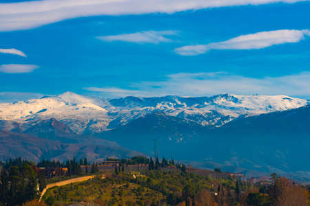 Panoramic view of Sierra Nevada with green forest.