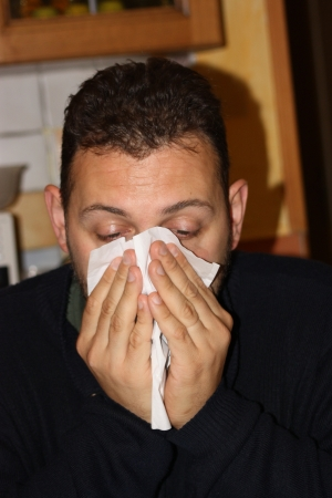 rheum: Man blowing his nose