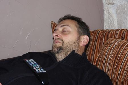 man asleep watching TV
