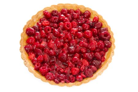 whole raspberry tart isolated on white