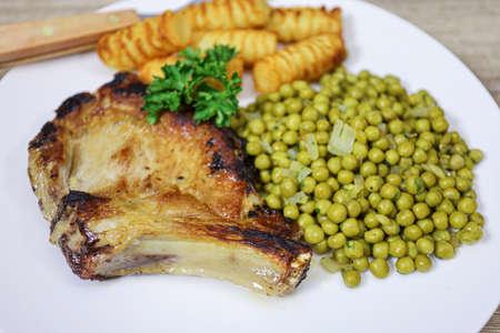 pork chop, peas and potatoes